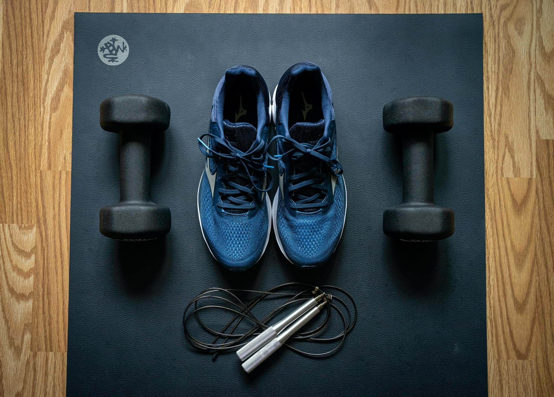 trainers skipping rope weights are seen placed on a work out mat on the floor
